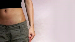 Slim woman with too big trousers Stock Footage