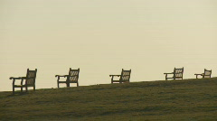 Seats on clifftop at sunset Stock Footage