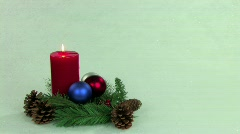 Christmas centerpiece with red candle Stock Footage