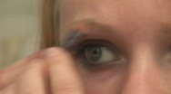 Stock Video Footage of HD1080i Young blond woman making herself a make up