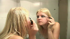 HD1080i Young blond woman making herself a make up Stock Footage