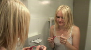 HD1080i Make-Up. Young blond girl in the bathroom. Stock Footage