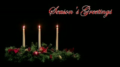 Seasons Greetings background with candle centerpiece Stock Footage