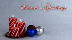 Seasons Greetings background with candle and decorations Stock Footage