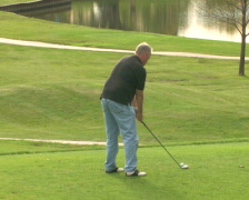 Golfer Tees Off 1 Stock Footage