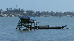 Stilt House and Boat Stock Footage