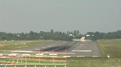 Plane landing at international airport Stock Footage