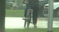 Bikes In The Rain 1 Stock Footage