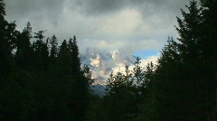 Clouds and Snow Cover Mount Rainier in Mount Rainier National Park, time lapse  Stock Footage