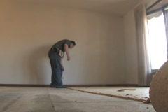 Man Removing Carpet Stock Footage