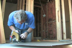 Man Uses Power Saw Stock Footage