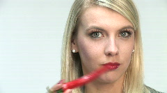 HD1080i Young blond girl with hot red chile pepper Stock Footage