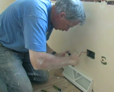 Installing Outlet 1 - stock footage