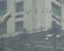 Construction workers in Beijing. Dangerous Walk. Stock Footage