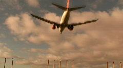 Passenger jet landing overhead Stock Footage