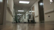Patient in Hospital Hallway Stock Footage