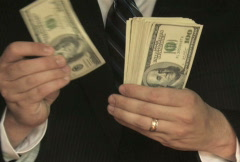 Counting Cash in Suit Stock Footage