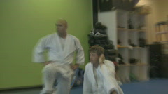STUDENT OBSERVES JIU JITSU INSTRUCTOR - stock footage