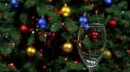 Serving red wine with holiday decorations in background Stock Footage