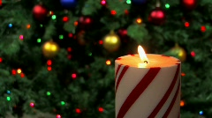 Holiday candle with decorations in backgrounds Stock Footage