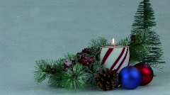 Holiday centerpiece with candle pine and decorations Stock Footage