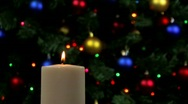 Candle with holiday decorations in backgrounds Stock Footage