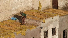 Man Laying Skins at Tannery Stock Footage