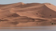 Stock Video Footage of Erg Chebbi Sahara Dunes with Oasis