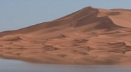 Stock Video Footage of Erg Chebbi Dunes Reflected in Oasis Sahara