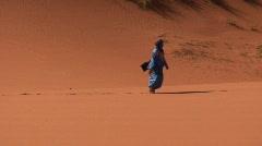 Berber Walking & Waving in Sahara Desert Stock Footage