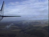 Rear facing aerial shot flying through clouds Stock Footage