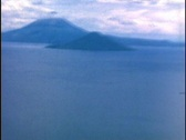 Stock Video Footage of Aerial Shot of a Smoking South American Volcano Vintage 16mm