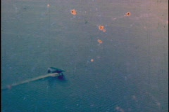 Vintage Plane Flying Over a Lake Water Skiing Stunt Wheel on Water  - stock footage