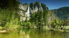 Yosemite falls reflection in pristine pond Stock Footage