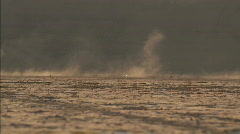 Desert drylake dirtbikes mountains 01 Stock Footage
