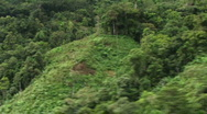 Stock Video Footage of Close aerial view of jungle mountainside