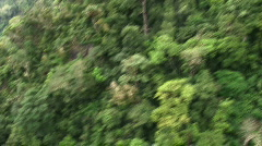 Aerial view of jungle mountain side - stock footage