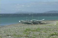 Philippine fishing boat on beach Stock Footage