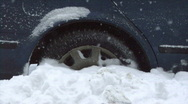 Car wheel stuck in the deep snow Stock Footage