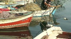 Small fishing boat sails into harbor Stock Footage