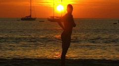 Nude woman beach sundown Stock Footage