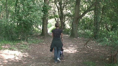 Young Mum Pushing Pushchair into Woods Stock Footage