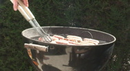 Sausages Cooking on a BarBeQue Stock Footage