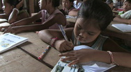 Stock Video of Cambodia: Children learn to read and write Stock Footage