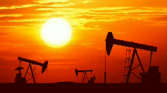 Oil pumps at sunset. Loopable. HD1080 progressive. - stock footage