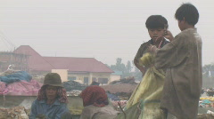 Cambodia: Children work at the city dump. - stock footage
