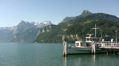 Small moored boat on Lake Luzern Switzerland Stock Footage