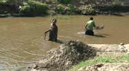 Stock Video Footage of Malawi: african women takes soil from the river bottom