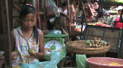 Cambodia: Working in the Market. - stock footage