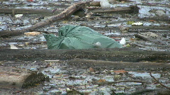 Garbage bag floating in the water. Stock Footage